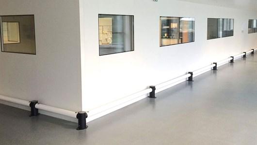 Single Traffic flexible polymer safety guardrail in corridor